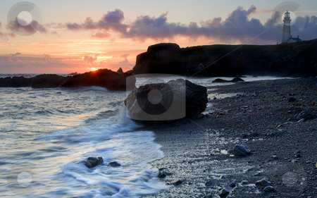 Lighthouse stock photo, Yaquina Head Lighthouse from Cobble beach as the sun sets over the Oregon Coast by Mike Dawson