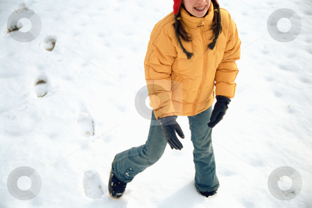 Girl playing in snow stock photo, Girl walking in the snow by Mpixis World