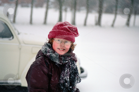 Boy in the snow stock photo, Child with glasses in the snow by Mpixis World