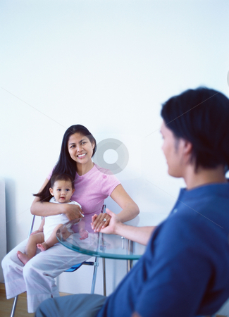 MPIXIS589021 stock photo, Young family at dining table by Mpixis World