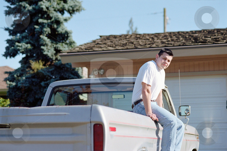 MPIXIS550178 stock photo, Man sitting on pick-up truck by Mpixis World