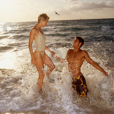 MPIXIS550568 stock photo, Couple playing in sea by Mpixis World