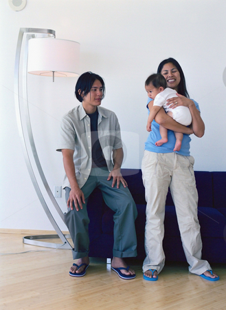 MPIXIS589061 stock photo, Young family in living room by Mpixis World