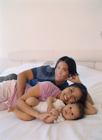 MPIXIS589001 stock photo, Young family resting on bed by Mpixis World