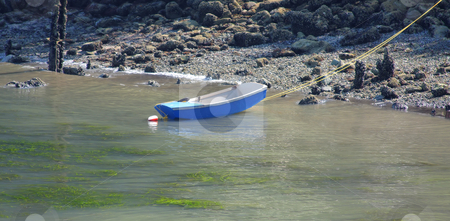 Rowboat at low tide  stock photo, Rowboat anchored near the beach at low tide. by Steve Stedman