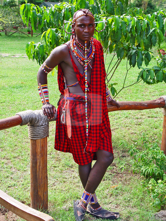 Masai guy stock photo, A young Massai man posing for the camera. He is the employee of a lodge in the Kimana National Park by Emmanuel Keller