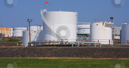 White Oil Tanks stock photo, Several white storage tanks for oil at a refinery. by Steve Stedman