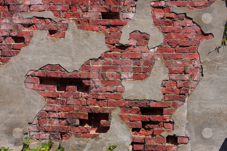 Old Brick and Stucco stock photo, Old brick wall with decaying stucco exterior. by Steve Stedman