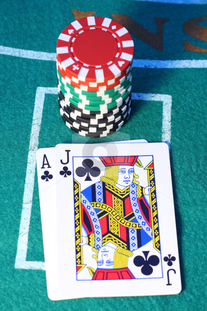Blackjack stock photo, Blackjack and a stack of chips on a felt background by Steve Stedman