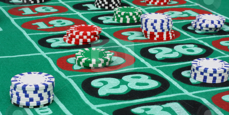 Roulette Game with Chips stock photo, Roulette table with multi-colored chips. by Steve Stedman