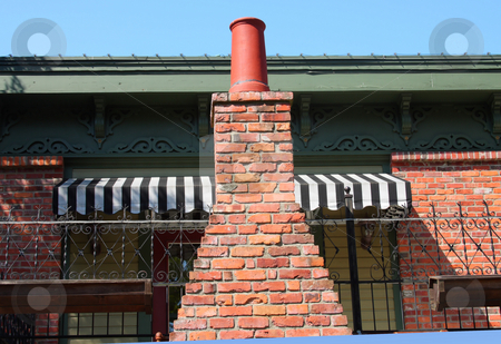 Chimney and awning stock photo, A fireplace chimney and a 2nd floor awning. by Steve Stedman