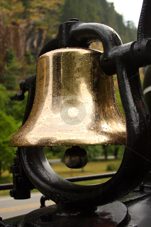 Train Bell stock photo, Brass train bell with water droplets in the rain. by Steve Stedman