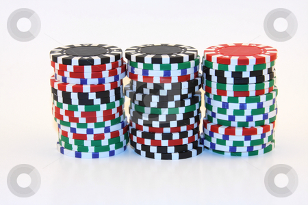 Casino Chips stock photo, Gambling chips in red, green and black piles. by Steve Stedman