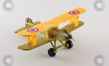 Toy Biplane stock photo, Isolates shot of a toy airplane. by Steve Stedman