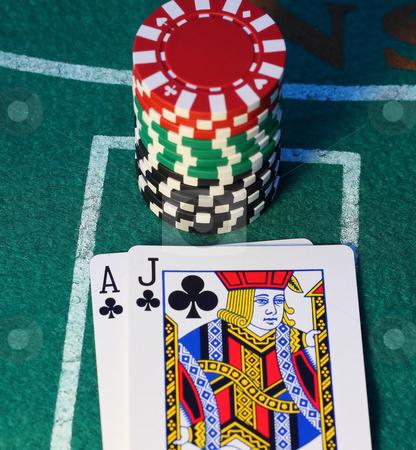 Blackjack stock photo, Blackjack and a stack of chips on a felt background by Steve Stedman