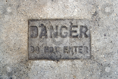 Danger Do Not Enter stock photo, A cement sign that says danger do not enter by Richard Nelson