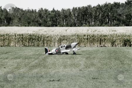 Hobby Plane stock photo, A small remote control hobby plane sitting in a field by Richard Nelson