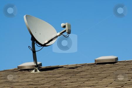 Home Satellite stock photo, A small home satellite on the roof by Richard Nelson