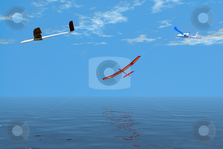 Leisurely Flight stock photo, Three model airplanes flying over the ocean on a leisurely flight by Richard Nelson
