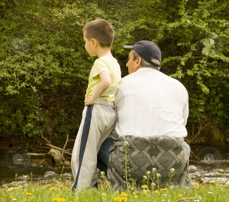 Grandpa and grandson stock photo, Grandpa and grandson enjoying the sun by Ivan Paunovic