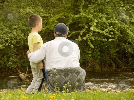Grandpa and grandson stock photo, Grandpa and grandson enjoying the sun by Ivan Paunovic