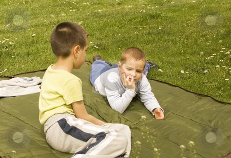 Springtime stock photo, Two boys on a blanket enjoying the sunny day by Ivan Paunovic