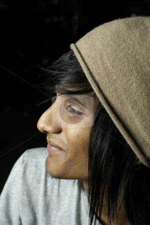 Indian man profile wearing beanie hat stock photo, Young  indian man profile wearing beanie hat by Wong Chee Yen