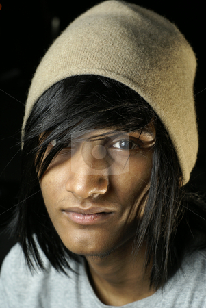 Young indian man wearing beanie hat stock photo, Young indian man wearing beanie hat by Wong Chee Yen