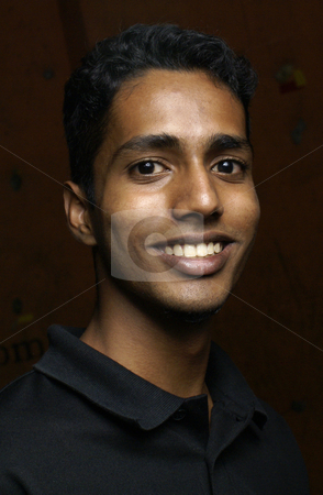 Smiling young indian man portrait stock photo, Smiling young indian man portrait by Wong Chee Yen