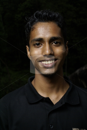 Young smiling indian man portrait stock photo, Young smiling indian man portrait by Wong Chee Yen