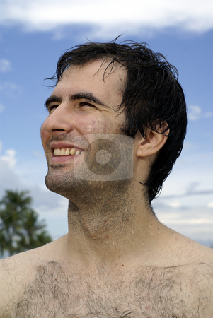 Caucasian man smiling outdoors stock photo, Caucasian man at beach smiling by Wong Chee Yen
