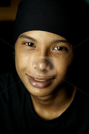 Man Smiling stock photo, Youthful asian man with black beanie headwear. by Wong Chee Yen
