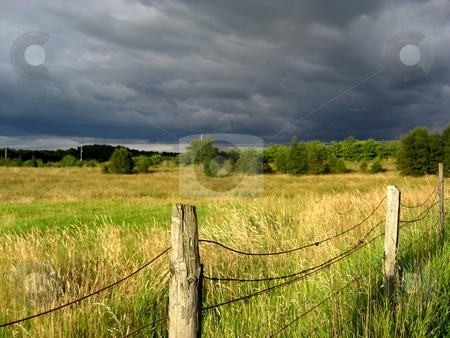 Landscape with a fence stock photo, Rural landscape with a fence. by Juliet Photography