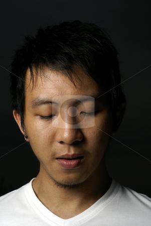 Asian teen looking downcast stock photo, Asian teen looking downcast by Wong Chee Yen