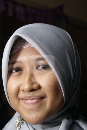 Smiling young muslim lady stock photo, Smiling young muslim asian lady by Wong Chee Yen