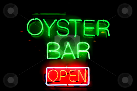 Oyster Bar stock photo, A big neon sign advertising an oyster bar. by Robert Byron