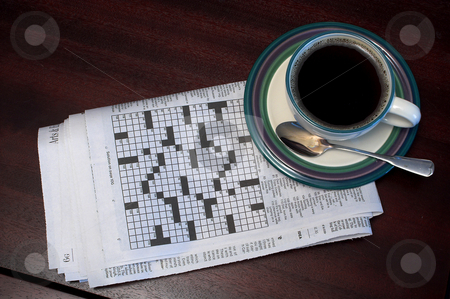 Morning Coffee stock photo, Morning coffee and the newspaper crossword puzzle. by Robert Byron