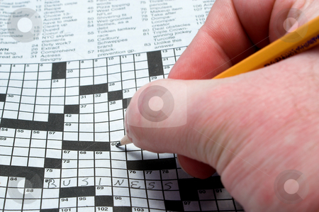 Crossword Puzzle stock photo, A man doing a newspaper crossword puzzle. by Robert Byron
