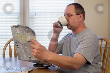 Man Drinking Coffee stock photo, A man drinking his morning coffee. by Robert Byron