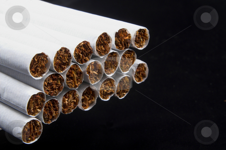 Cigarettes stock photo, A bunch of nicotine laden tobacco cigarettes. by Robert Byron