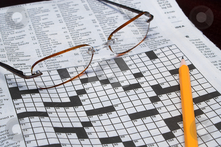Crossword Puzzle stock photo, A Crossword Puzzle, pencil and a set of reading glasses. by Robert Byron