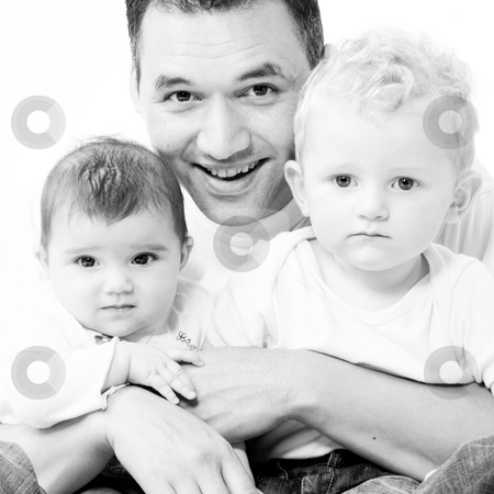 Dad with his children stock photo, Cute brother and sister from different races having fun with daddy by Frenk and Danielle Kaufmann