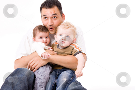 Daddy giving a grouphug stock photo, Cute brother and sister from different races having fun with daddy by Frenk and Danielle Kaufmann