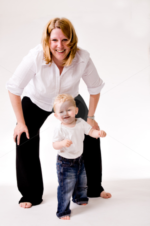 Playing with mom stock photo, Cute caucasian blond toddler is happy with his mother by Frenk and Danielle Kaufmann
