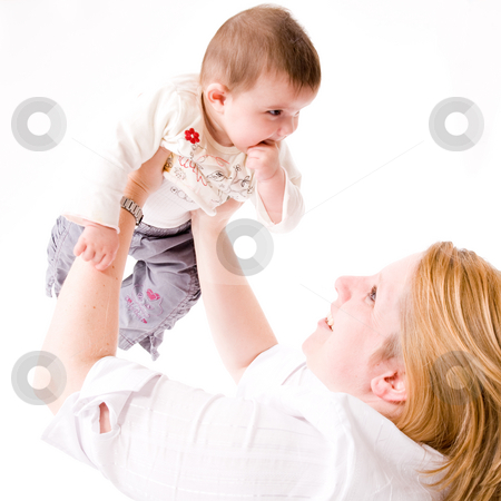 Holding up the baby stock photo, Cute asian baby hugging with her mother by Frenk and Danielle Kaufmann