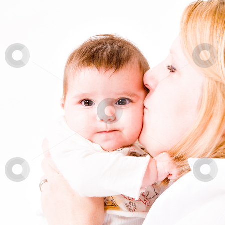 Kissing the baby stock photo, Cute asian baby hugging with her mother by Frenk and Danielle Kaufmann
