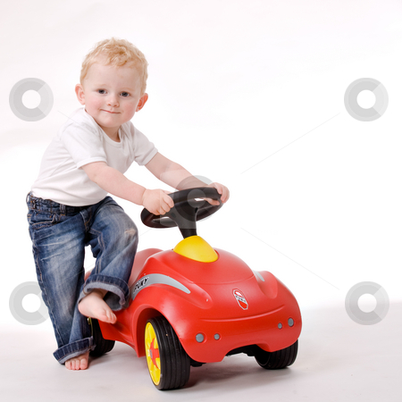 Me and my red car stock photo, Cute caucasian blond toddler ishappy and playfull by Frenk and Danielle Kaufmann