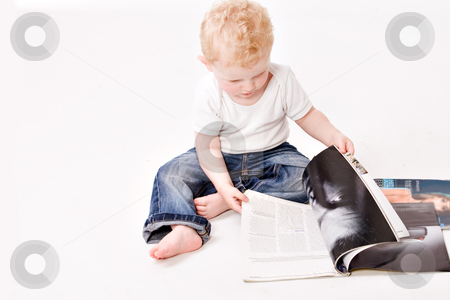 Check the magazines stock photo, Cute caucasian blond toddler ishappy and playfull by Frenk and Danielle Kaufmann