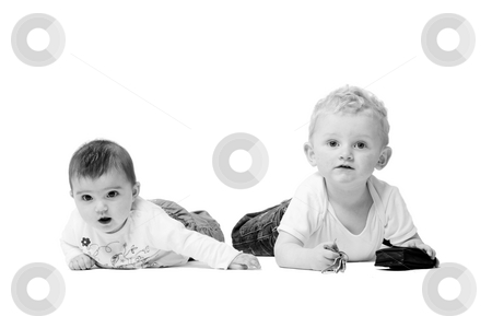 Children on the ground stock photo, Cute brother and sister from different races having fun together by Frenk and Danielle Kaufmann