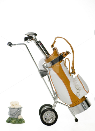 Golf Bag and bucket of Balls stock photo, Golf bag and clubs with a bucket of balls isolated by Robert Cabrera